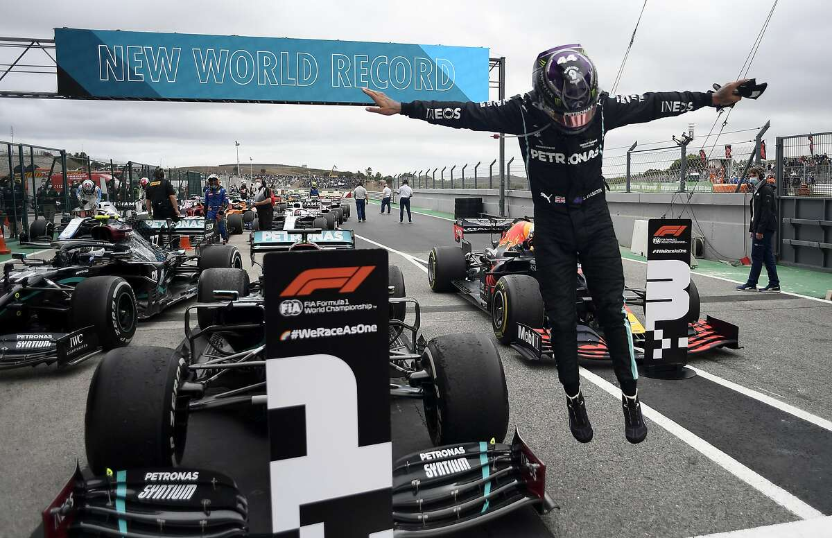 Mercedes driver Lewis Hamilton exults after his 92nd win, breaking the Formula One record, in Portimao, Portugal.