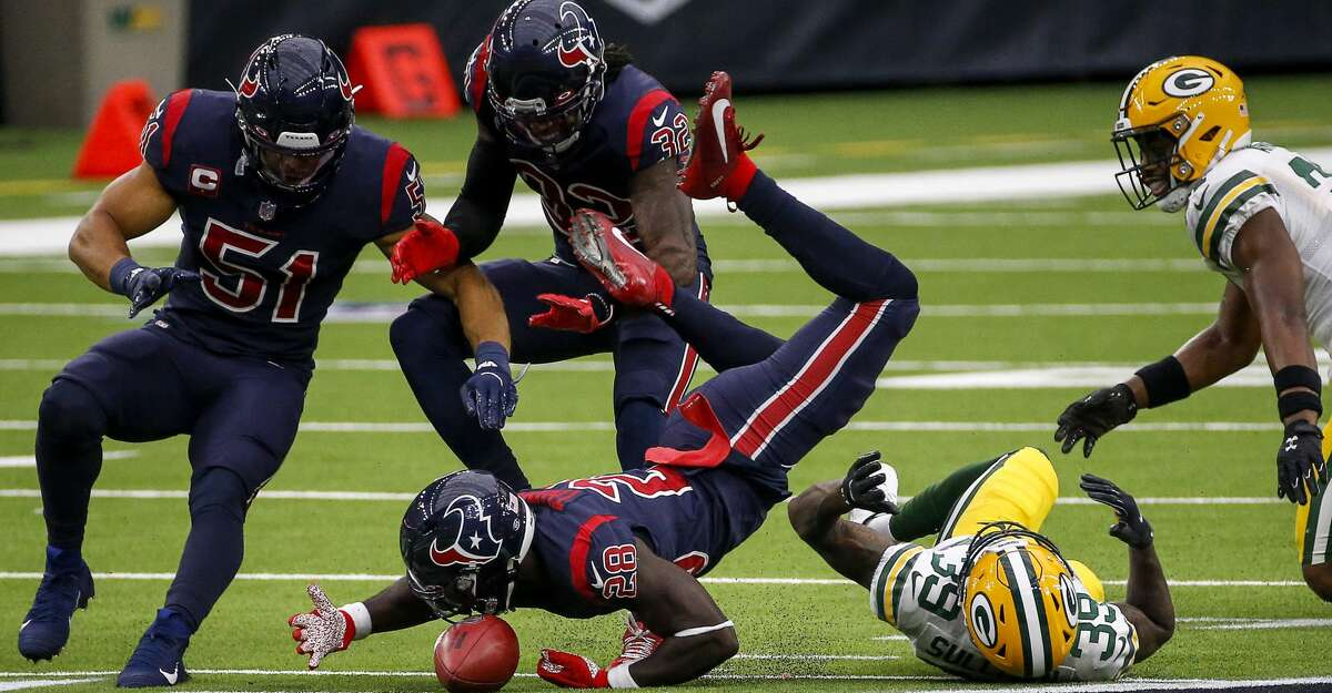Houston Texans defensive back Michael Thomas (28) recovers an onside kick as Houston Texans linebacker Dylan Cole (51) and cornerback Lonnie Johnson (32), Green Bay Packers cornerback Chandon Sullivan (39) and strong safety Adrian Amos (31) also go after the ball during the fourth quarter of an NFL game Sunday, Oct. 25, 2020, at NRG Stadium in Houston.