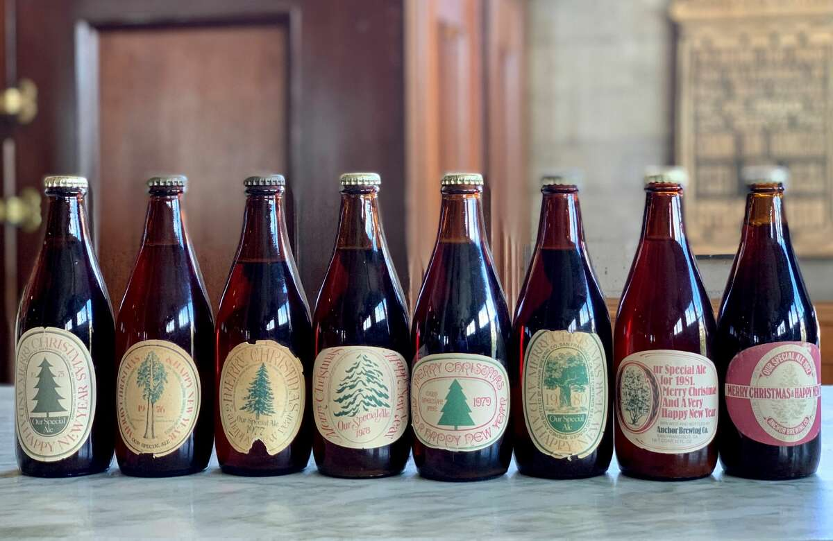 Bottles of Anchor Brewing Company's Christmas Ales from past years can be seen in this photo.