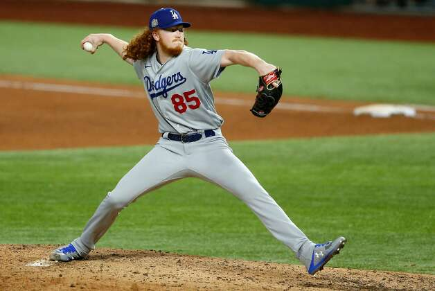Los Angeles Dodgers pitcher Dustin May works against the Tampa Bay Rays during the sixth inning in Game 5 of the World Series at Globe Life Field in Arlington, Texas, on Sunday, Oct. 25, 2020. (Vernon Bryant/Dallas Morning News/TNS) Photo: Vernon Bryant, TNS