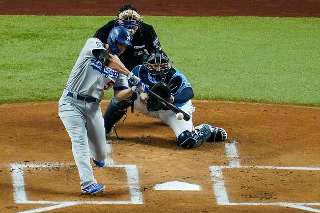 The Los Angeles Dodgers' Corey Seager drives in a run with a single during the first inning against the Tampa Bay Rays in Game 5 of the World Series at Globe Life Field in Arlington, Texas, on Sunday, Oct. 25, 2020. (Smiley N. Pool/Dallas Morning News/TNS) Photo: Smiley N. Pool, TNS