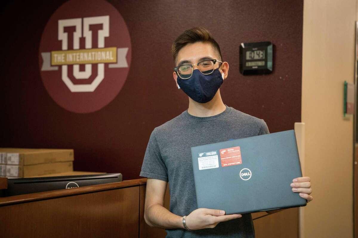 TAMIU student Alejandro Espinoza picks up his laptop for the fall semester as part of the university's Loaner Laptop Program.