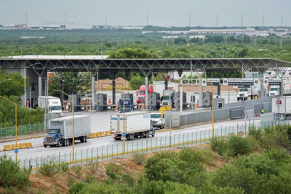 Truck drivers cross at the World Trade Bridge on Saturday morning after one driver's plan to organize a blockade in protest failed to materialize.