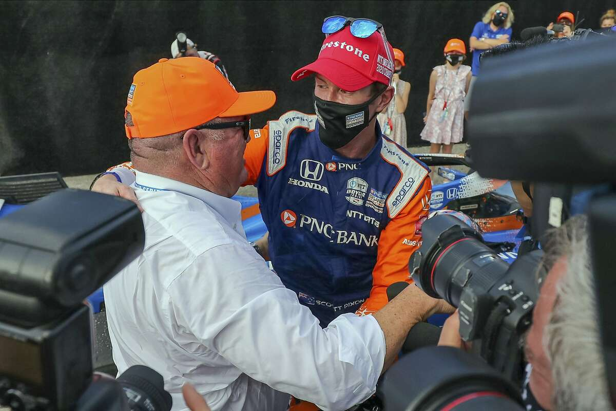 Team owner Chip Ganassi (left) congratulates Scott Dixon on winning the IndyCar championship for the sixth time.