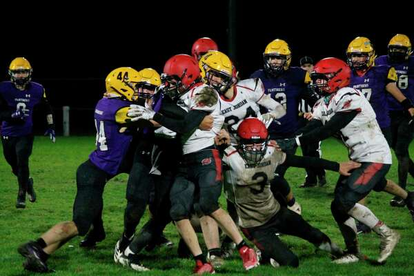 Jack Stefanski (4) leads a host of Panthers in wrapping swallowing up the East Jordan ball carrier on Oct. 23. (Photo/Robert Myers)