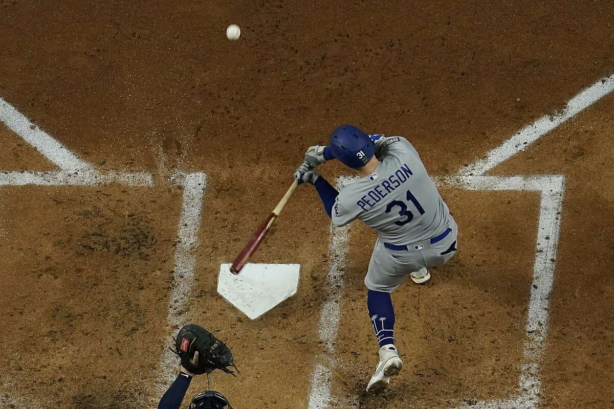 Los Angeles Dodgers' Joc Pederson hits a home run against the Tampa Bay Rays during the first inning in Game 5 of the baseball World Series Sunday, Oct. 25, 2020, in Arlington, Texas.