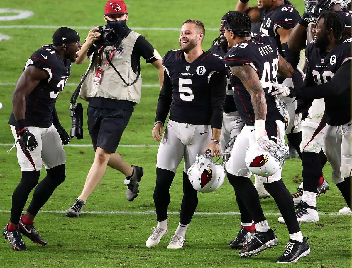 GLENDALE, ARIZONA - OCTOBER 25: Place kicker Zane Gonzalez #5 of the Arizona Cardinals smiles as he celebrates with safety Chris Banjo #31 and linebacker Kylie Fitts #49 after Gonzalez kicked the game-winning field goal against the Seattle Seahawks with 20 seconds remaining in overtime at State Farm Stadium on October 25, 2020 in Glendale, Arizona. The Cardinals defeated the Seahawks 37-34 in overtime. (Photo by Christian Petersen/Getty Images)
