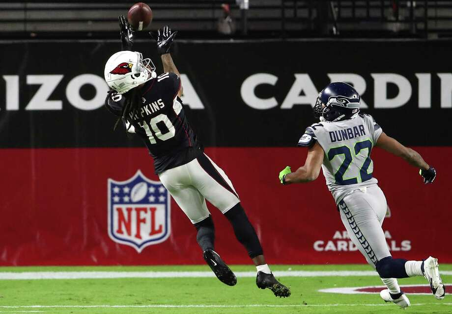GLENDALE, ARIZONA - OCTOBER 25: Wide receiver DeAndre Hopkins #10 of the Arizona Cardinals makes a catch and runs for a touchdown as cornerback Quinton Dunbar #22 of the Seattle Seahawks looks on in the first quarter of the game at State Farm Stadium on October 25, 2020 in Glendale, Arizona. Photo: Christian Petersen, Getty Images / 2020 Getty Images
