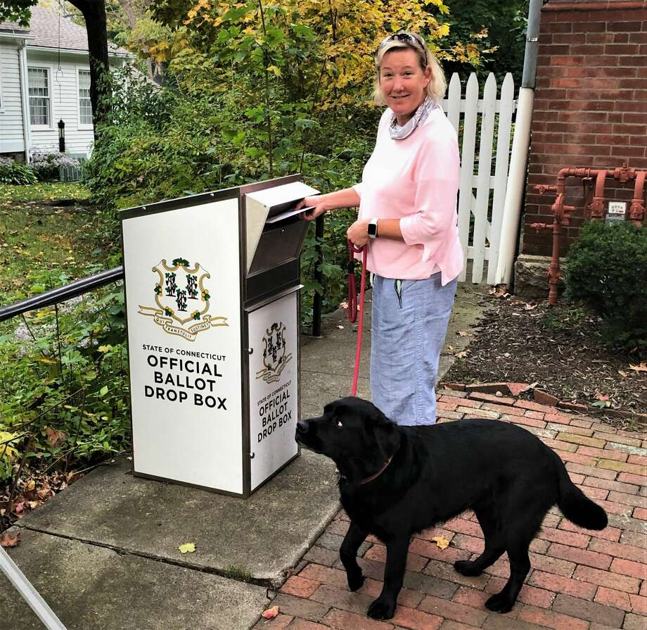 Stephanie Johnson dropped off her absentee ballot at Guilford town hall last week, posing as her husband, Phil Johnson, captured the historic moment. Photo: Photo Courtesy Of Phil Johnson
