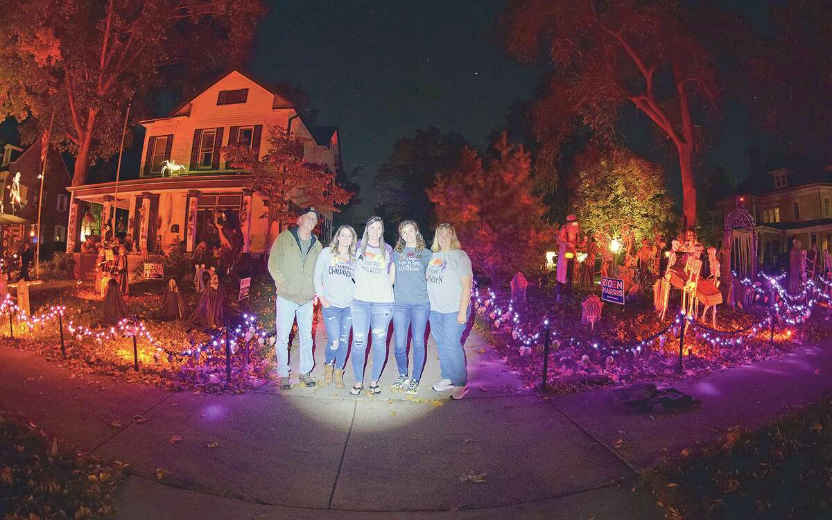The Sieving family in front of their Halloween-decorated home on West State Street: Mike (from left), Ashley, Stephanie, Rosemary and Kim.
