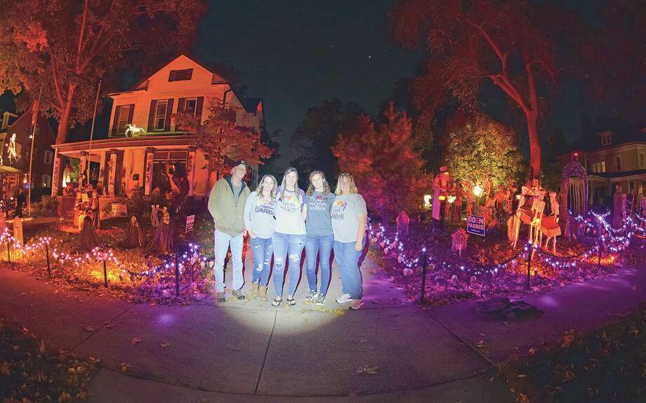 The Sieving family in front of their Halloween-decorated home on West State Street: Mike (from left), Ashley, Stephanie, Rosemary and Kim. Photo: David Blanchette   Journal-Courier