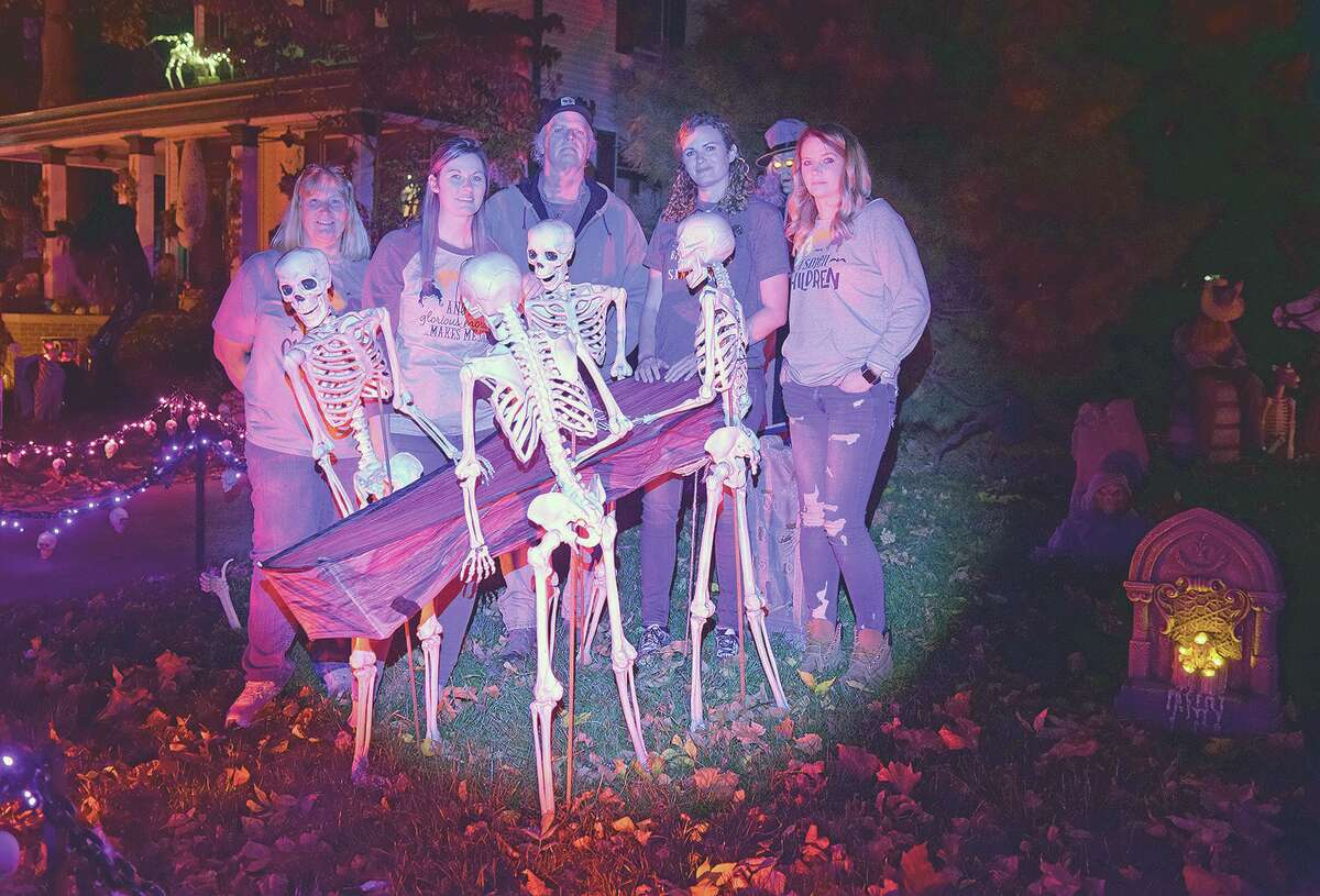 The Sieving family amid coffin-carrying skeletons in their front yard. They are Kim (from left), Stephanie, Mike, Rosemary (Mo) and Ashley Sieving.