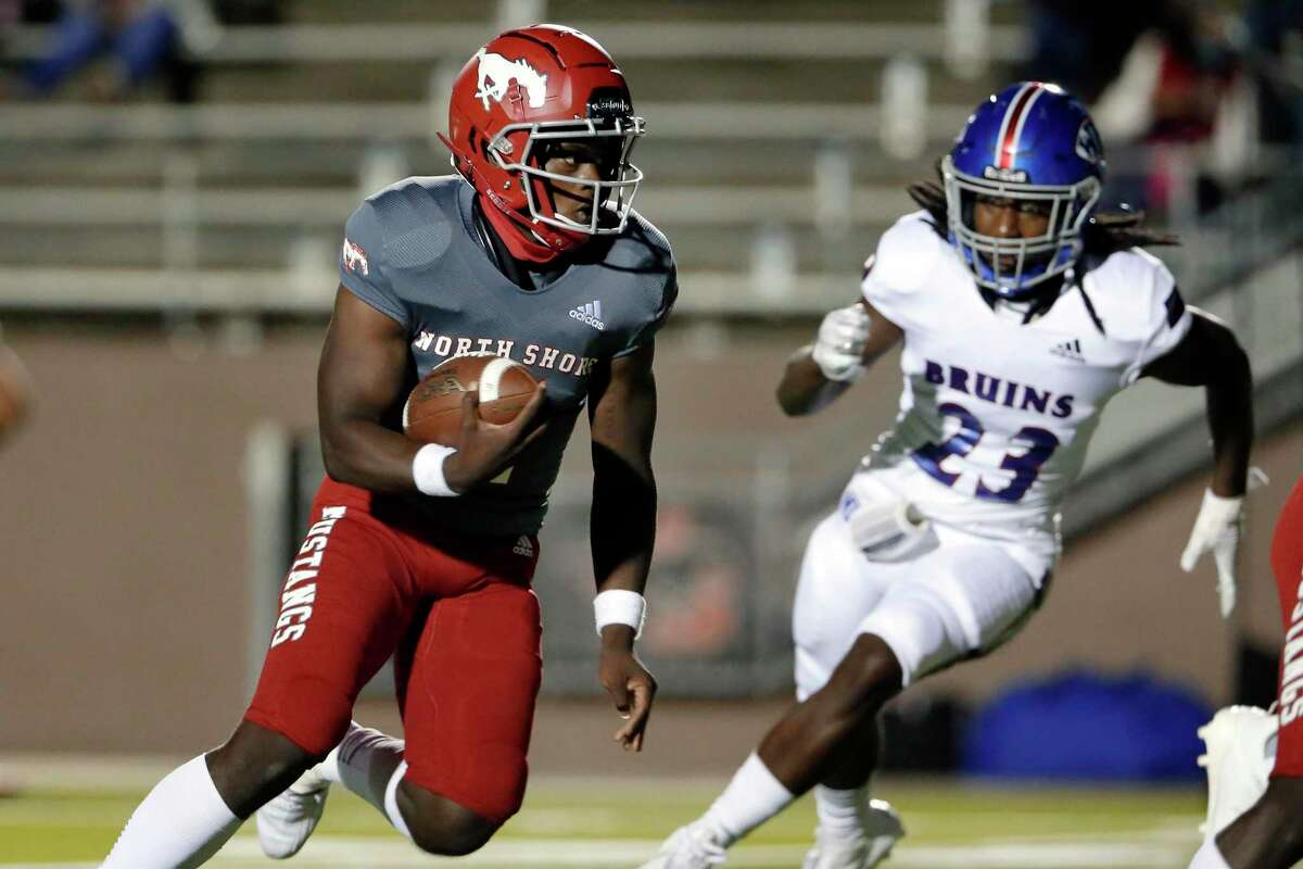 North Shore quarterback Dematrius Davis (4) runs in a touchdown past West Brook defender Kenneth Durousseau (23) during the first half of a high school football game Friday, Oct. 23, 2020 at GPISD Stadium in Houston, TX.