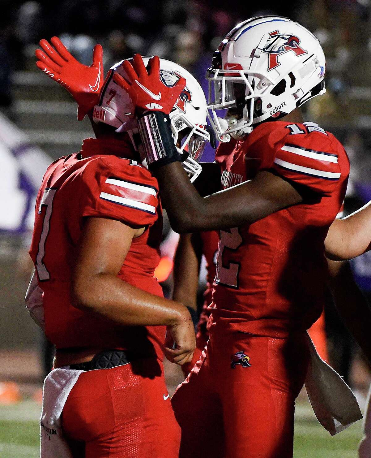 Atascocita quarterback Gavin Session, left, celebrates his touchdown with Keith Wheeler during the second half of a high school football game against Humble, Friday, Oct. 23, 2020, in Humble.