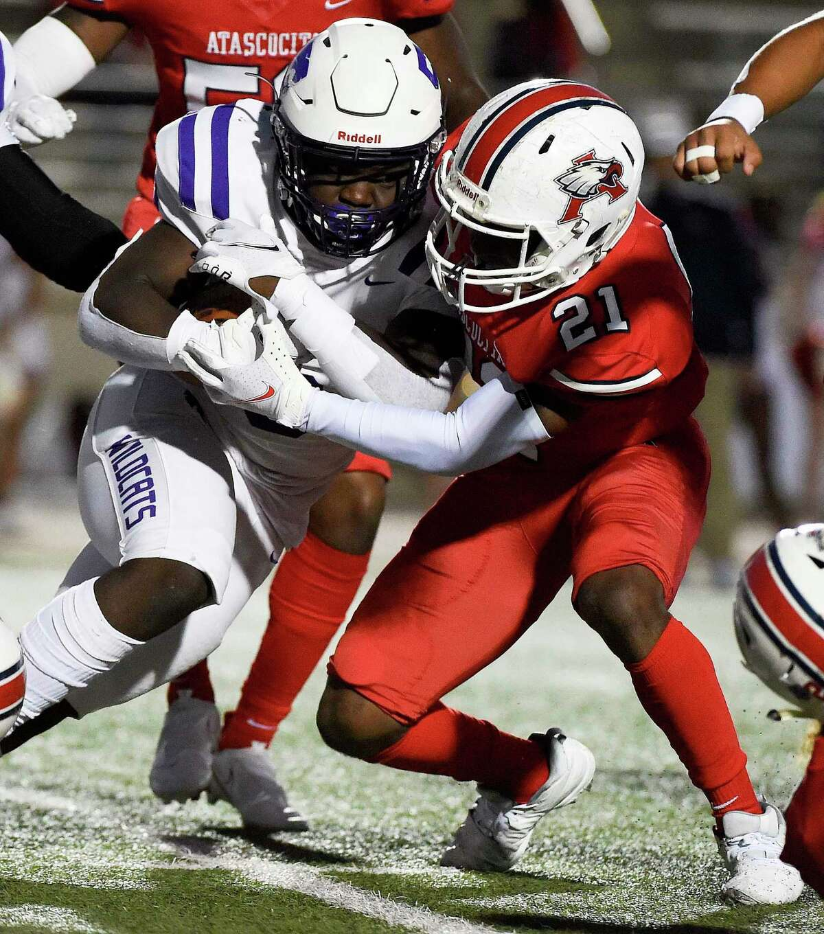 Humble running back X'Zavier Sidney, left, is tackled by Atascocita linebacker Jameer Martin (21) during the first half of a high school football game, Friday, Oct. 23, 2020, in Humble.