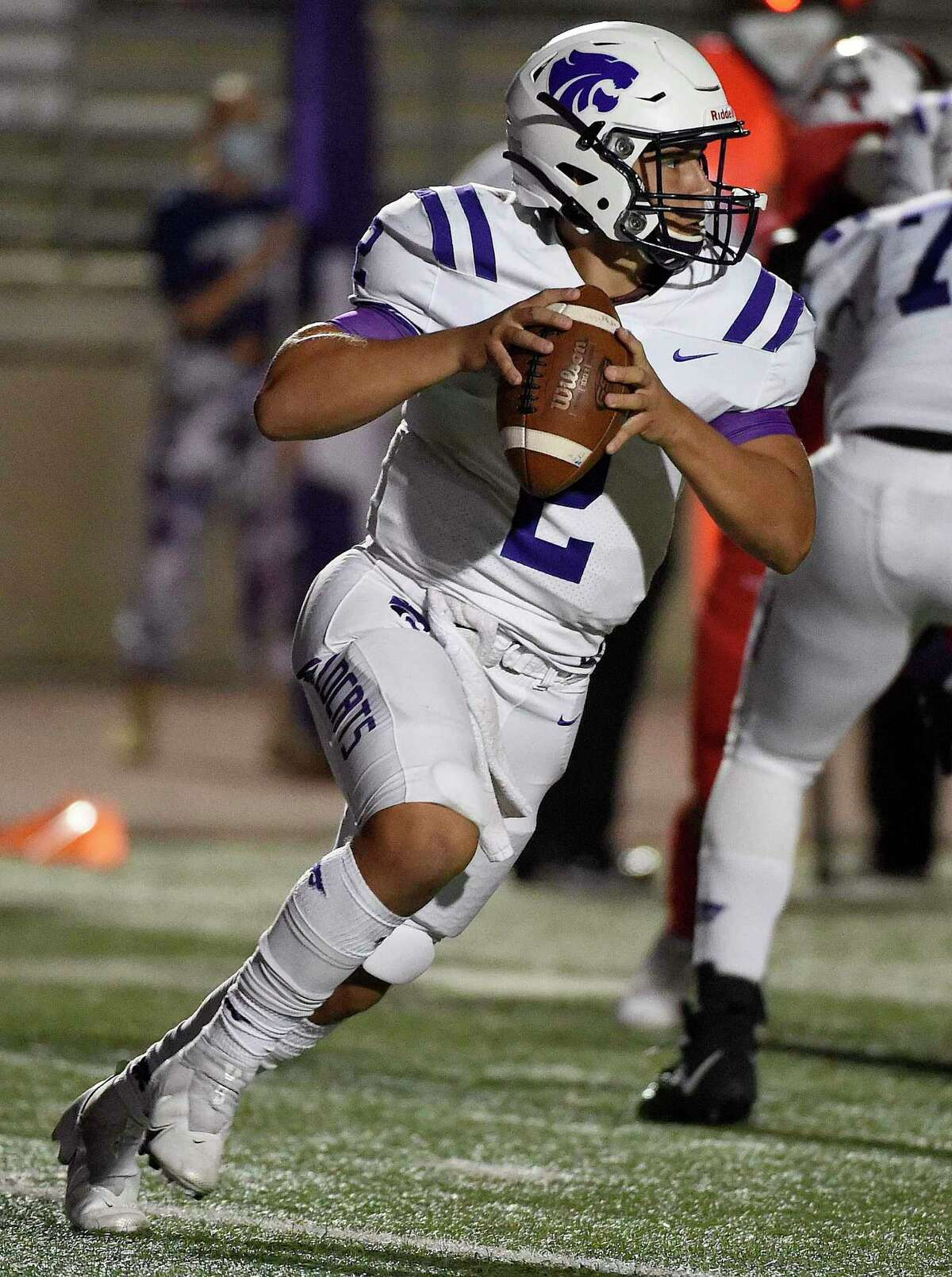 Humble quarterback Jeremiah Price Scott scrambles during the first half of a high school football game against Atascocita, Friday, Oct. 23, 2020, in Humble.