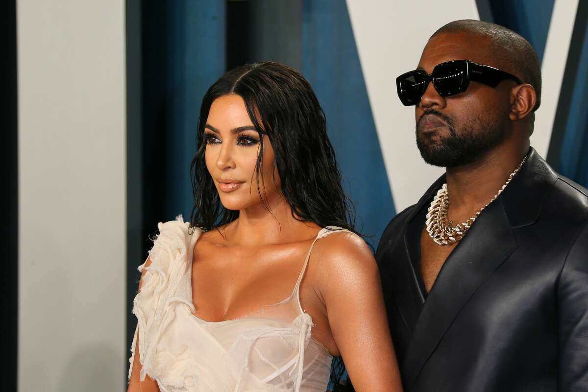 US media personality Kim Kardashian (L) and husband US rapper Kanye West attend the 2020 Vanity Fair Oscar Party following the 92nd Oscars at The Wallis Annenberg Center for the Performing Arts in Beverly Hills on February 9, 2020. (Jean-Baptiste Lacroix/AFP via Getty Images)