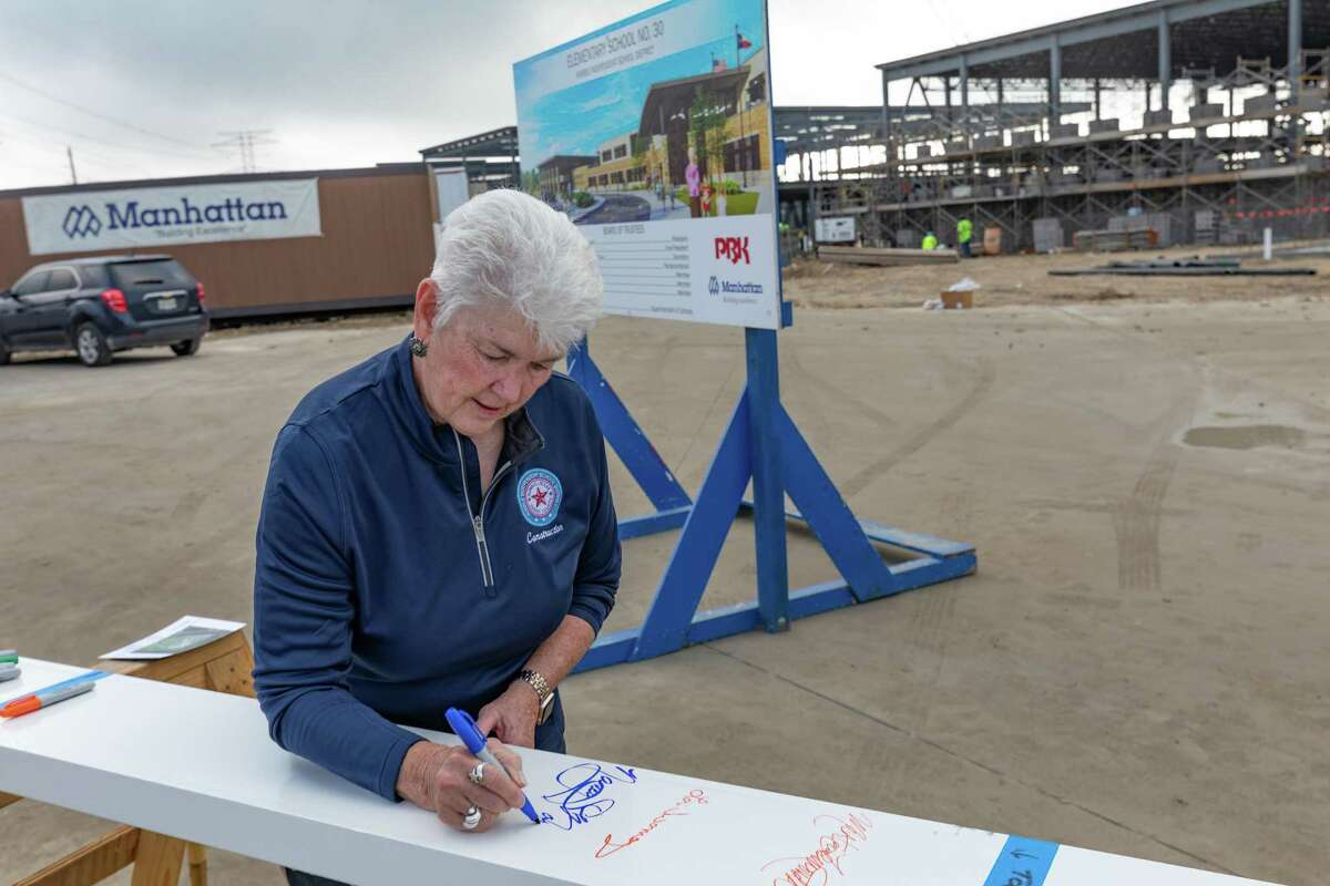 Nancy Morrison, Humble ISD School Board Trustee, signs a construction beam at the Elementary 30 groundbreaking on Oct. 23.