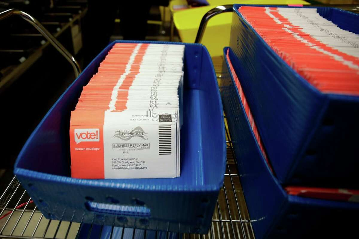 Vote-by-mail ballots for the August 4 Washington state primary are pictured at King County Elections in Renton, Washington on August 3, 2020. (Photo by Jason Redmond / AFP) (Photo by JASON REDMOND/AFP via Getty Images)