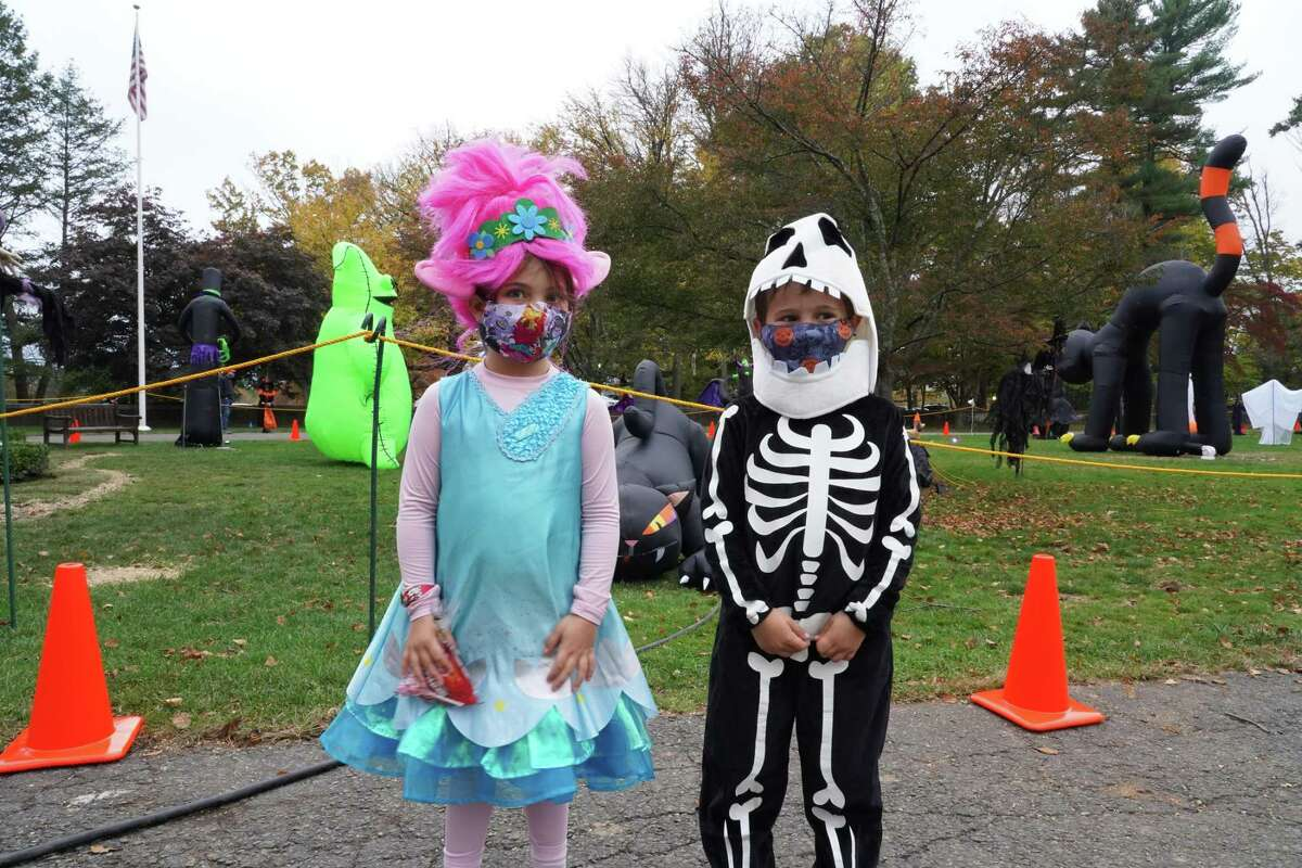 Georgia Azzopardi, 5, dressed as a troll and John McRedmond dressed as a skeleton at the New Canaan Recreation Department's