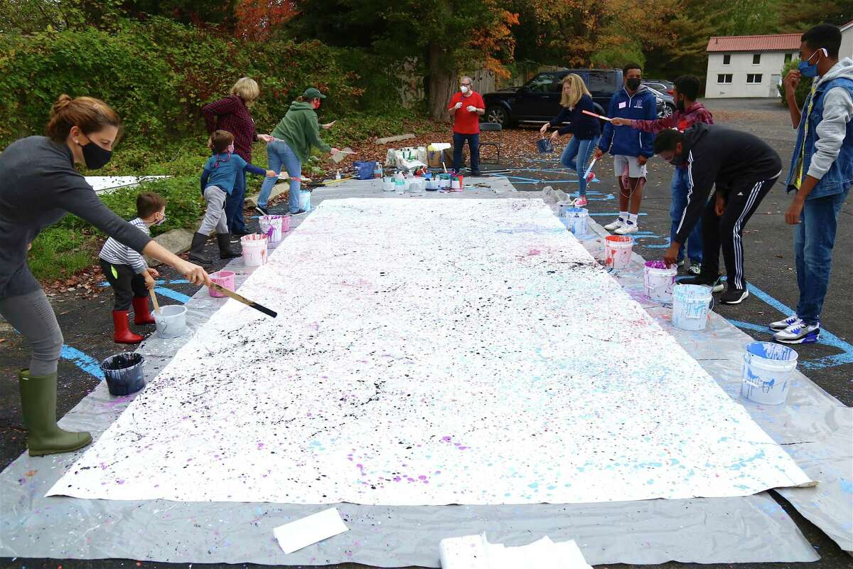 The enormous canvas used for the abstract mural painting at MoCA Westport on Saturday, Oct. 24, 2020, in Westport, Conn.