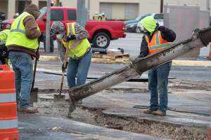 Workers bundle up 10/26/2020 doing work at the intersection of A Street and Texas as temperatures hovered around the freezing point. Tim Fischer/Reporter-Telegram