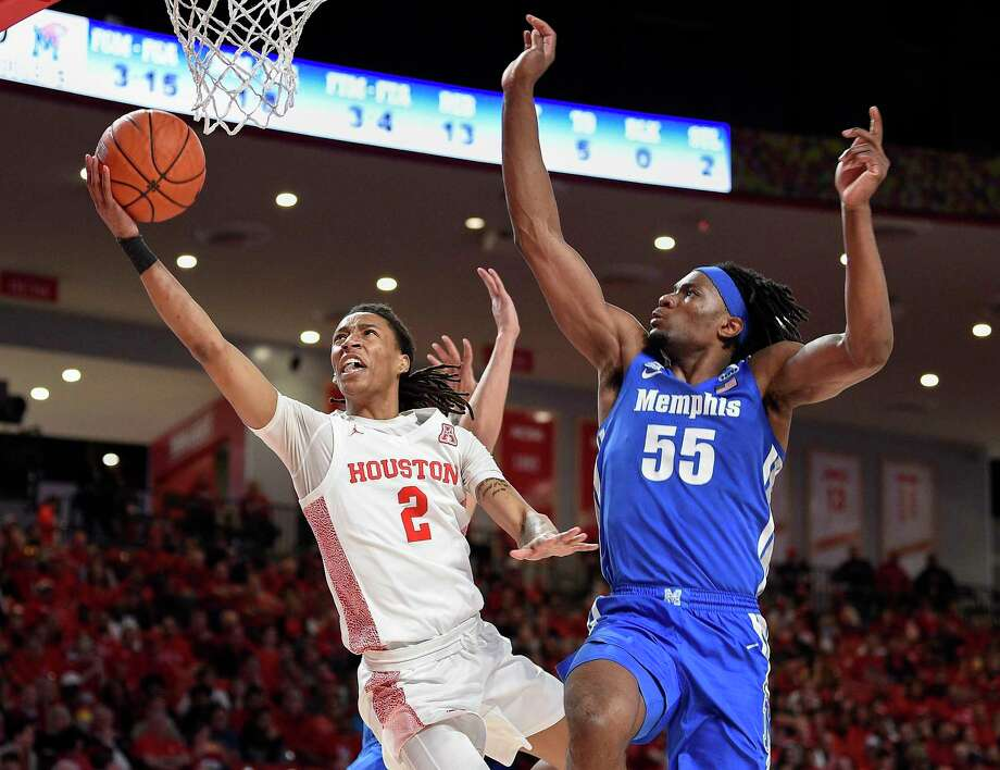 Precious Achiuwa, right, defending against Houston's Caleb Mills, has athleticism, rebounding prowess and strong defensive instincts, but struggles with turnovers and offense. Photo: Eric Christian Smith /Contributor / Houston Chronicle
