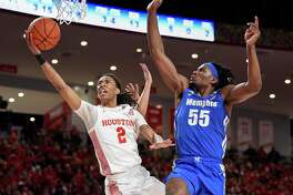 Precious Achiuwa, right, defending against Houston's Caleb Mills, has athleticism, rebounding prowess and strong defensive instincts, but struggles with turnovers and offense.