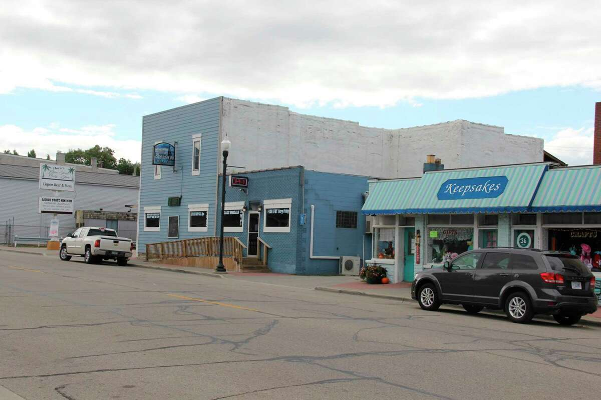 Some of the storefronts along Main Street in Caseville. Merchants in the city are still planning to go ahead with year-end sales on the first weekend of November. (Robert Creenan/Huron Daily Tribune)