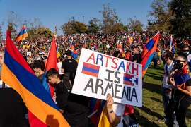 People march from Pan Pacific Park to the Consulate General of Turkey, during a protest in support of Armenia and Karabakh amid the territorial dispute with Azerbaijan over Nagorno-Karabakh, in Los Angeles, California, October 11, 2020. (Photo by KYLE GRILLOT / AFP) (Photo by KYLE GRILLOT/AFP via Getty Images)