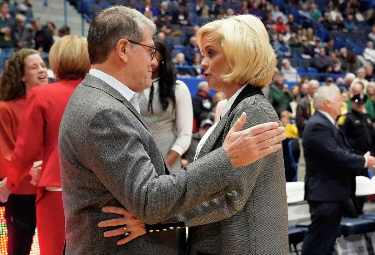 Connecticut coach Geno Auriemma, left, and Baylor coach Kim Mulkey talk before an NCAA college basketball game Thursday, Jan. 9, 2020, in Hartford, Conn. (AP Photo/Jessica Hill)