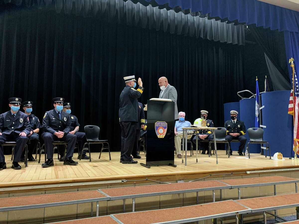 Firefighter Christopher Rosa, with his hand raised at center, was sworn in by East Haven Mayor Joe Carfora on Friday, Oct. 23, as a new East Haven Fire Department battalion chief, replacing recently retired Battalion Chief James Oca. Six probationary firefighters also were sworn in.