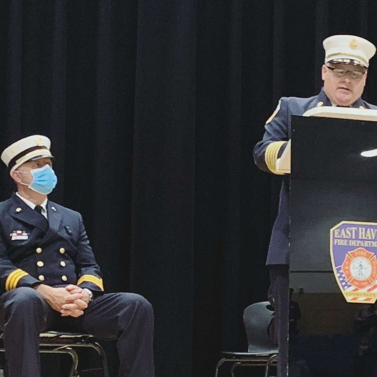 Firefighter Christopher Rosa, left, was sworn in on Friday, Oct. 23, as a new East Haven Fire Department battalion chief, replacing recently retired Battalion Chief James Oca. Fire Chief Matt Marcarelli, right, was among the speakers. Six probationary firefighters also were sworn in.