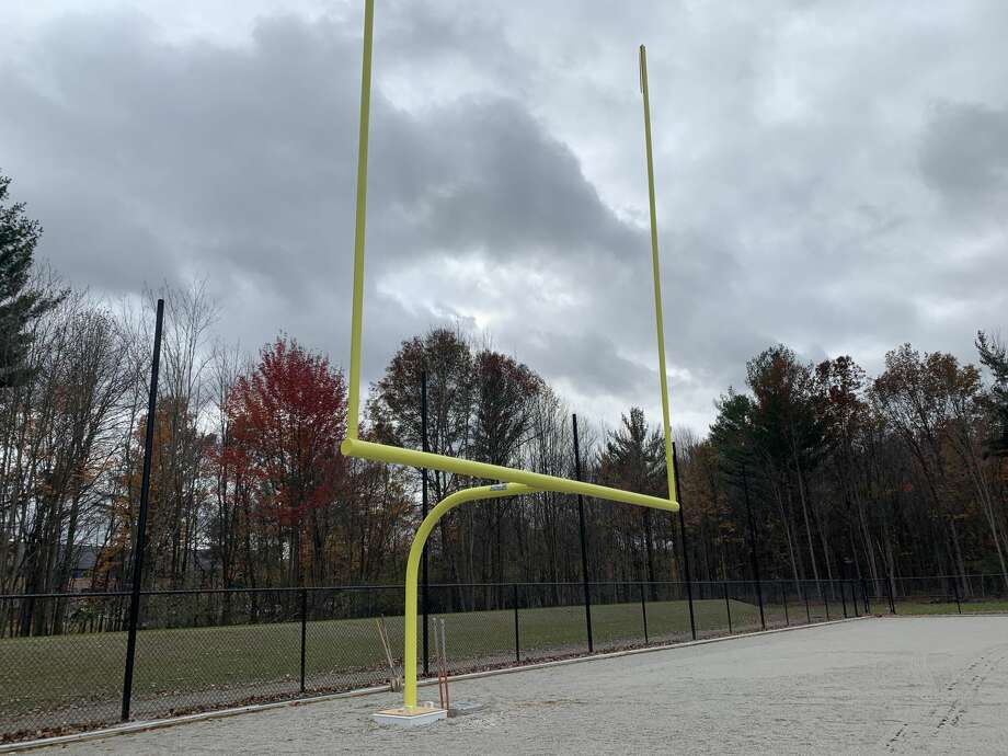Progress has continued on the construction of a new turf field at Dow High. Goal posts have been erected, and the field now awaits the installation of the artificial turf surface, which is expected to be completed sometime in November. Photo: Fred Kelly/fred.kelly@mdn.net