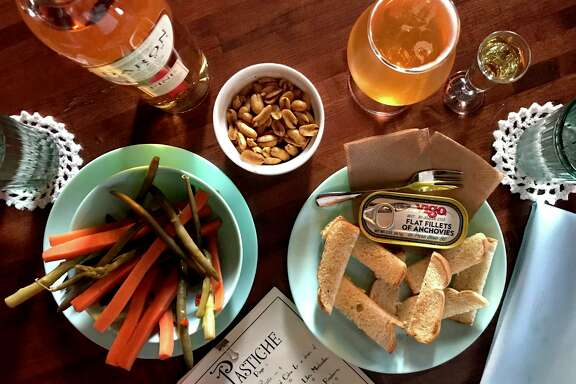 A selection of bar snacks including pickles, Old Bay peanuts and anchovies with toast at Pastiche.