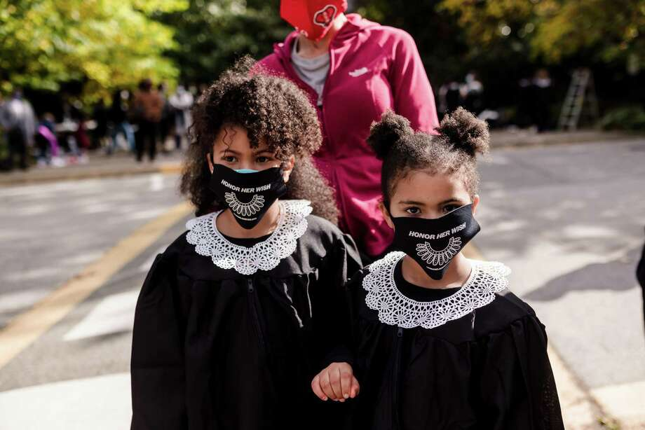 Sisters Madison, 8, and Morgan Moore, 5, protest Amy Coney Barrett's nomination to the Supreme Court. Photo: Kirth Bobb. /  Kirth Bobb
