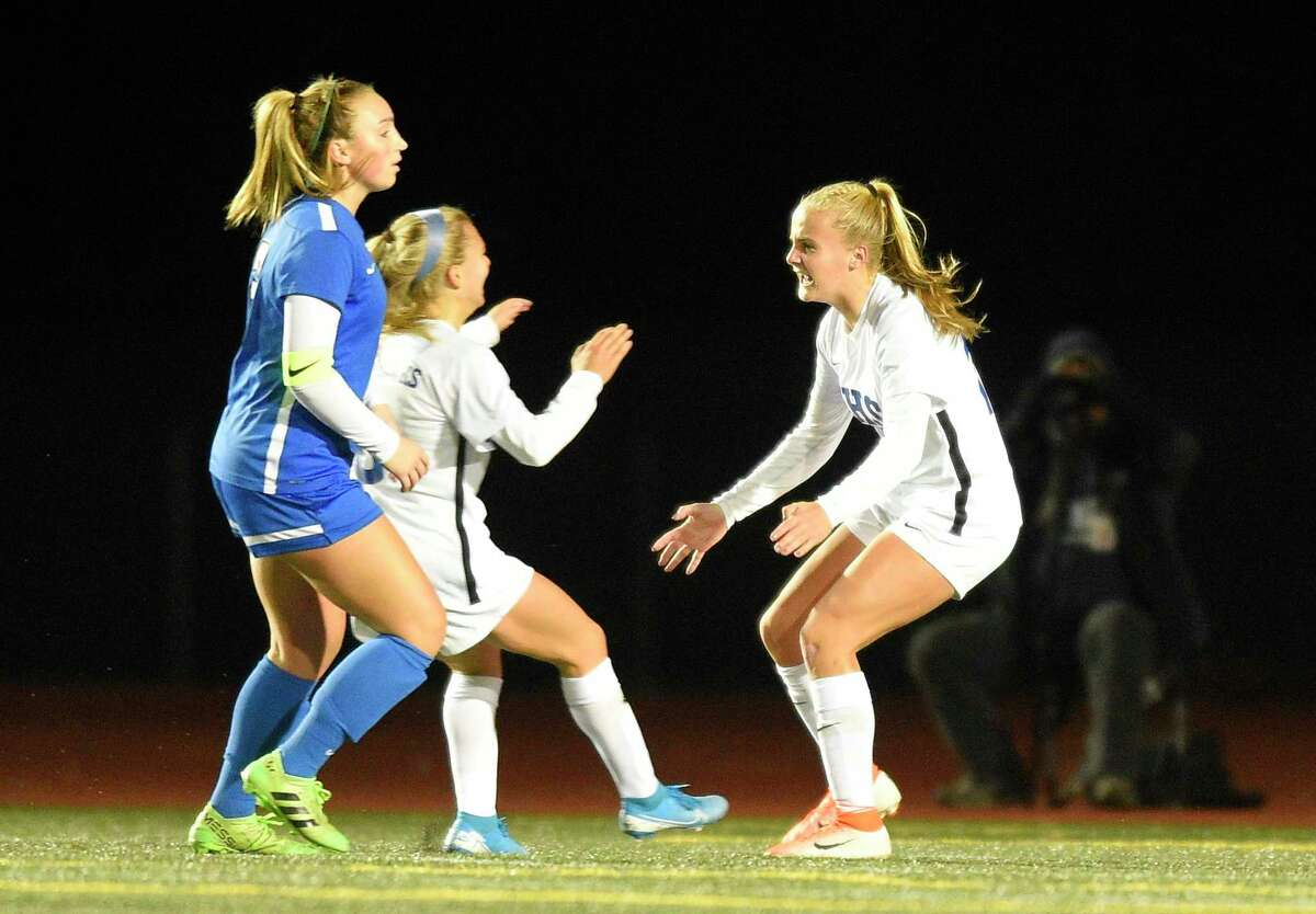 Glastonbury's Samantha Forrest, right, set the school record for career goals last week.