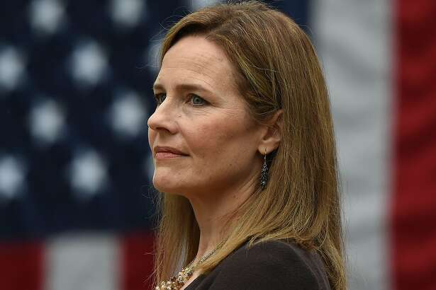 (FILES) In this file photo Judge Amy Coney Barrett is nominated to the US Supreme Court by President Donald Trump in the Rose Garden of the White House in Washington, DC on September 26, 2020. - Despite trailing in the polls barely one week from election day, US President Donald Trump on October 26, 2020 will likely celebrate a monumental victory for the conservative cause: his third nominee confirmed onto the US Supreme Court. Appellate Judge Amy Coney Barrett is all but certain to become the ninth justice on the nation's highest court, after Democrats failed to derail the contentious process in a sharply divided Senate. (Photo by Olivier DOULIERY / AFP) (Photo by OLIVIER DOULIERY/AFP via Getty Images)