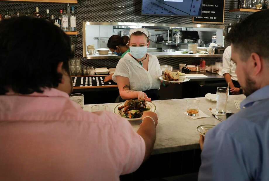 Gillian Dickerson serves meals to customers at The Hayden, a new Jewish delicatessen-inspired restaurant on Broadway that opened in October. Photo: Bob Owen / ©2020 San Antonio Express-News