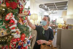Bee Dickson shops for an ornament at Bering's Hardware Thursday, Oct. 22, 2020, in Houston. Bering's Hardware is one of some 500 local stores offering 20 percent discounts to those who've donated to the American Cancer Society this season