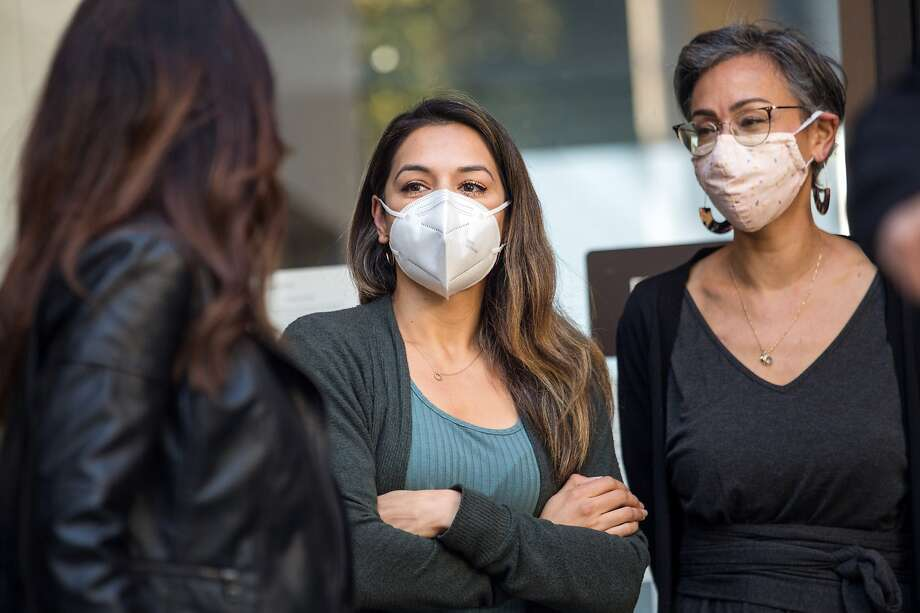 Gabriela Lopez, center, with Alison Collins, right, at an event in front of SFUSD headquarters on October 26, 2020. Photo: Jana Asenbrennerova / Special To The Chronicle