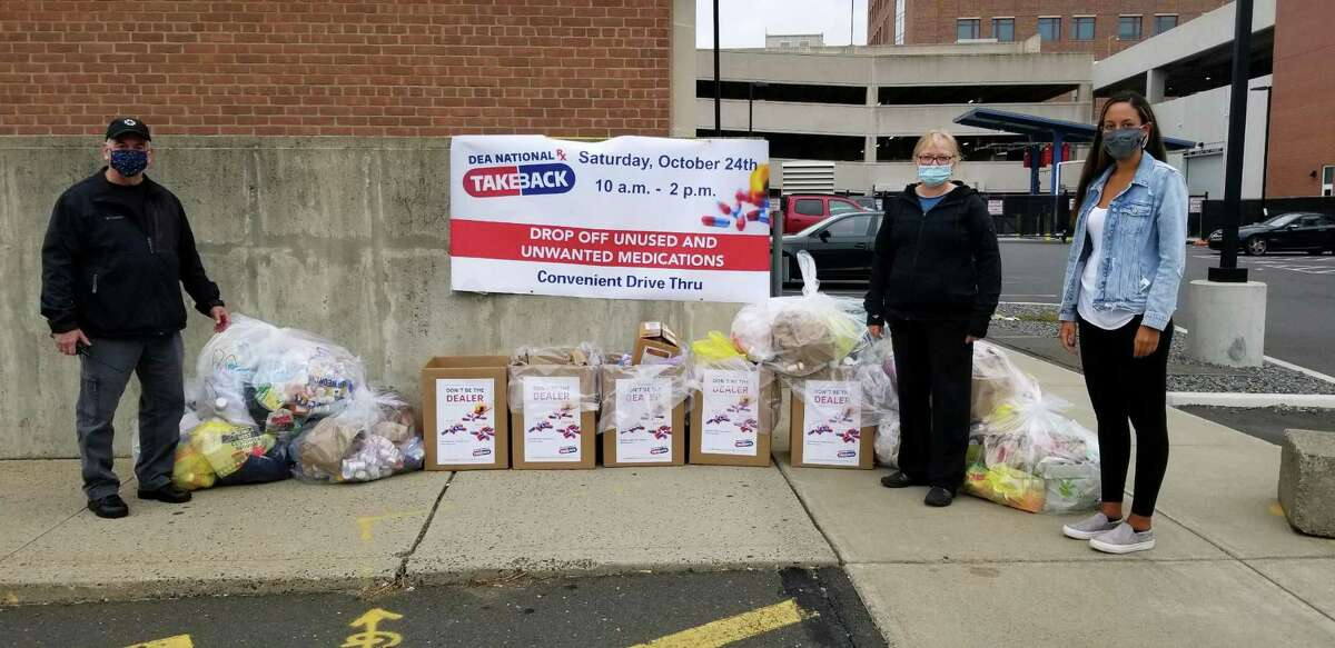 Capt. Richard Conklin (left) standing across from Ingrid Gillespie, director of prevention at Liberation Programs Inc., and (far right) Daniella Arias, program manager at The Hub, the Behavioral Health Action Organization for Southwestern Connecticut. The group collected a record 699 pounds of unwanted superscription drugs.
