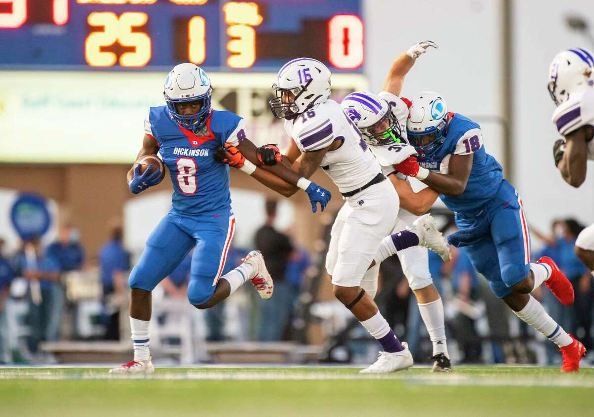Dickinson running back Ausaru Allah (8) tries to run past Ridge Point defensive back Joseph Ceasar during a high school football game between the Dickinson Gators and the Ridge Point Panthers, Friday, October 2, 2020, at Sam Vitanza Stadium in Dickinson.