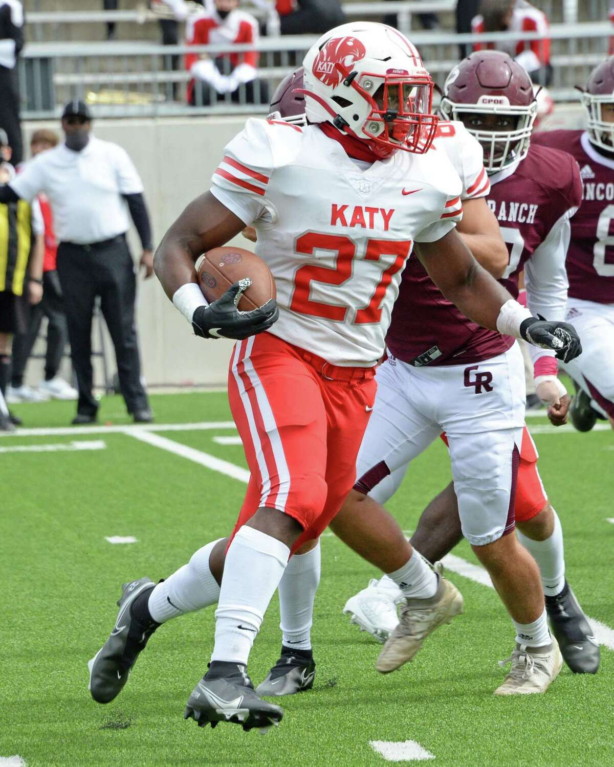 Derrick Williams (27) of Katy carries the ball during the fourth quarter of a 19-6A football game between the Cinco Ranch Cougars and the Katy Tigers on Saturday, October 24, 2020 at Legacy Stadium, Katy, TX.
