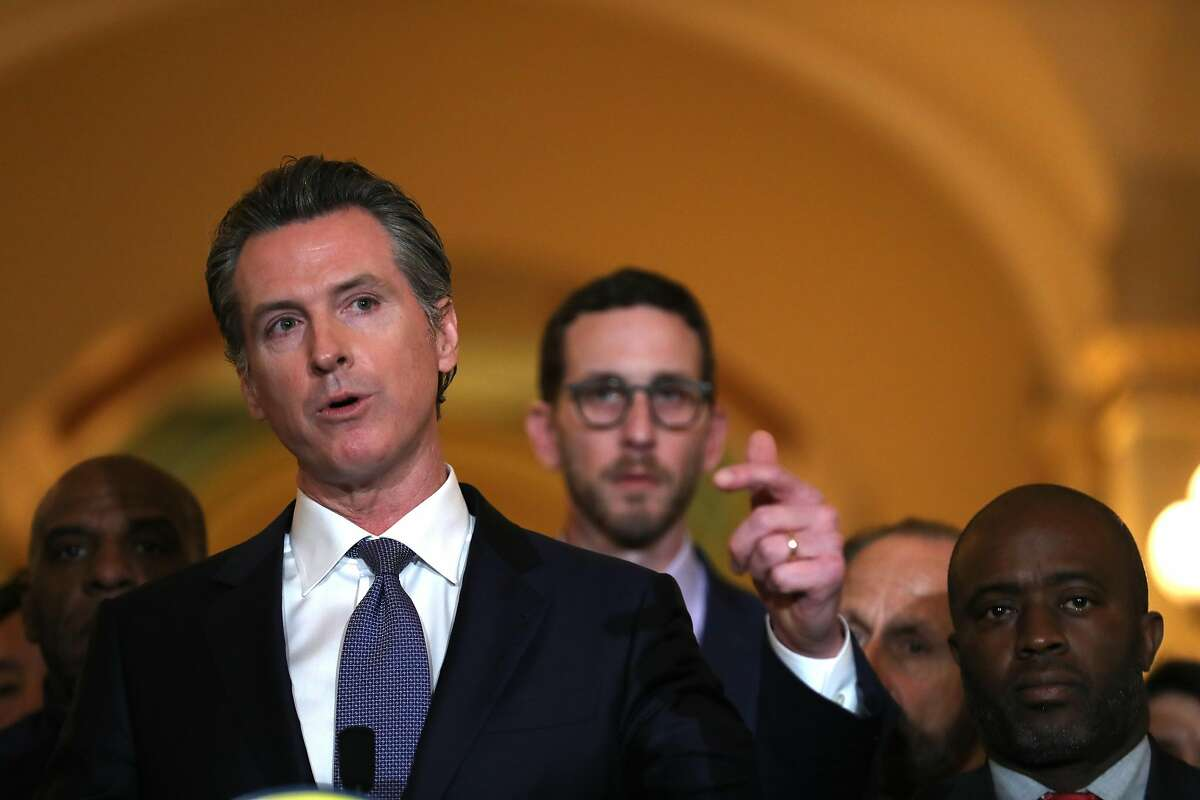 Gov. Gavin Newsom speaks at a news conference in March 2019 after placing a moratorium on executions.