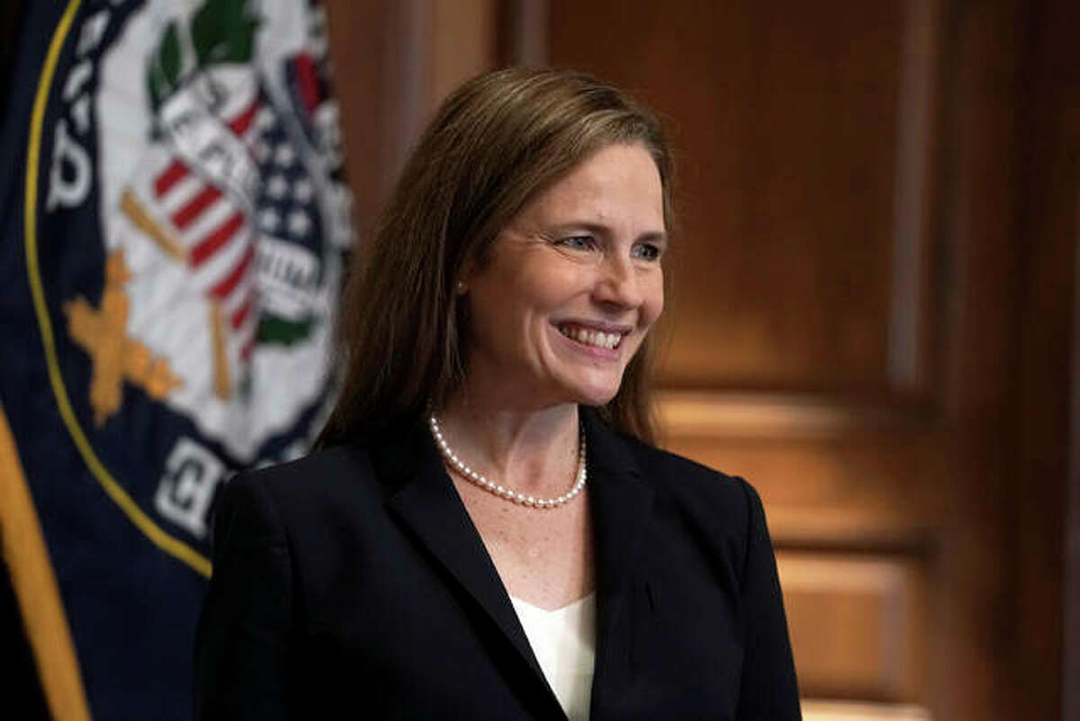 Supreme Court nominee Amy Coney Barrett, meets with Sen. Martha McSally, R-Ariz., Wednesday, Oct. 21, 2020, on Capitol Hill in Washington. Barrett was confirmed by the Senate Monday night, in a 52-48 vote. Illinois' Sens. Dick Durbin and Tammy Duckworth, both Democrats, voted against the confirmation.