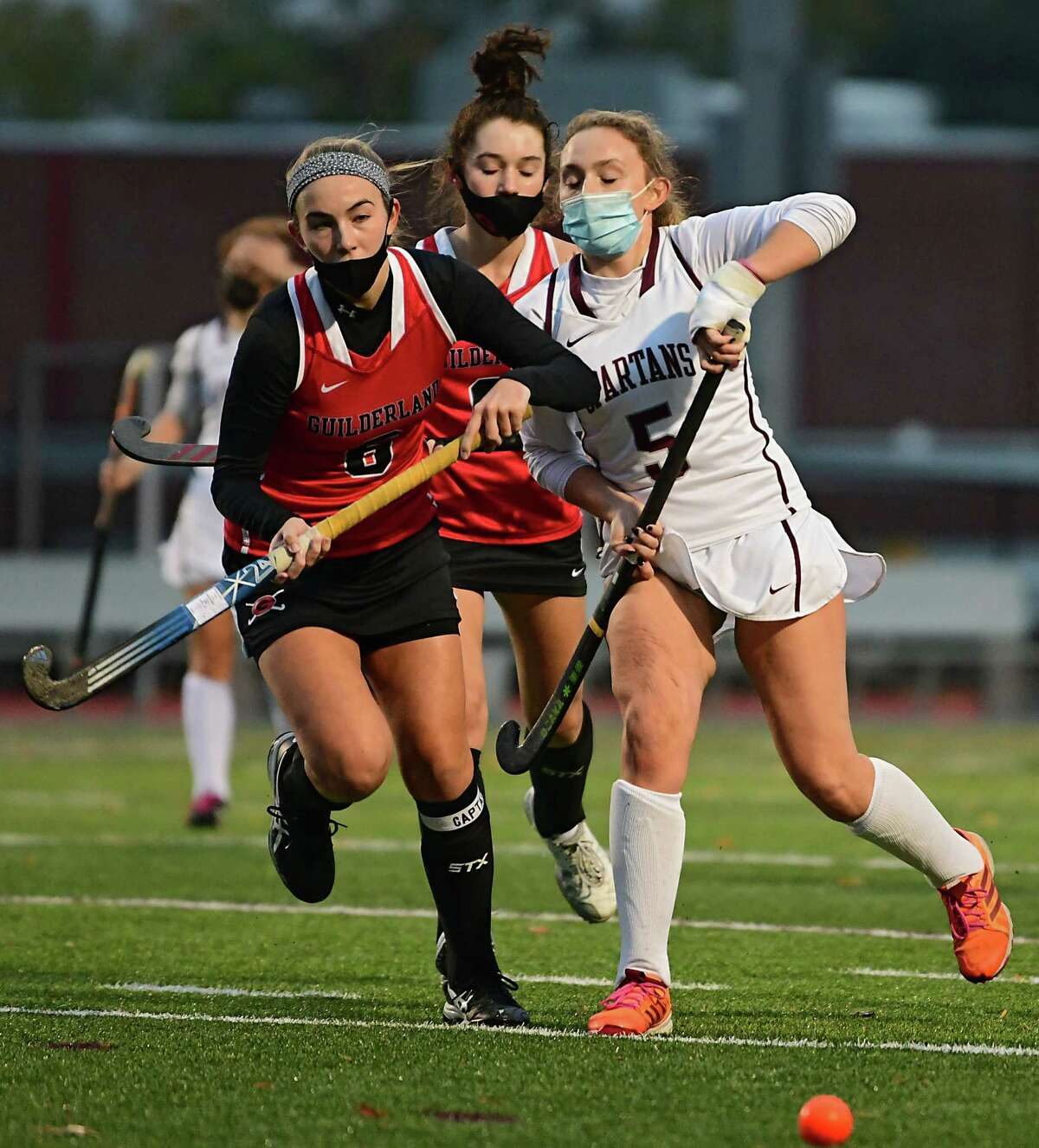 Guilderland's Sophia Sericolo, left, and Burnt Hills' Paige Thowe battle during a field hockey game on Monday, Oct. 26, 2020 in Burnt Hills, N.Y. (Lori Van Buren/Times Union)