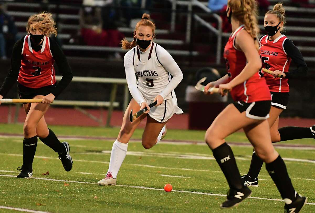 Burnt Hills' Isabel Adams, center, takes the ball down the field during a field hockey game against Guilderland on Monday, Oct. 26, 2020 in Burnt Hills, N.Y. (Lori Van Buren/Times Union)