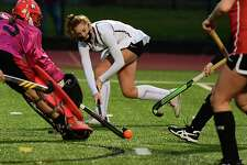Burnt Hills' Isabel Adams, center, tries to make an assist in front of Guilderland's goal during a field hockey game on Monday, Oct. 26, 2020 in Burnt Hills, N.Y. (Lori Van Buren/Times Union)