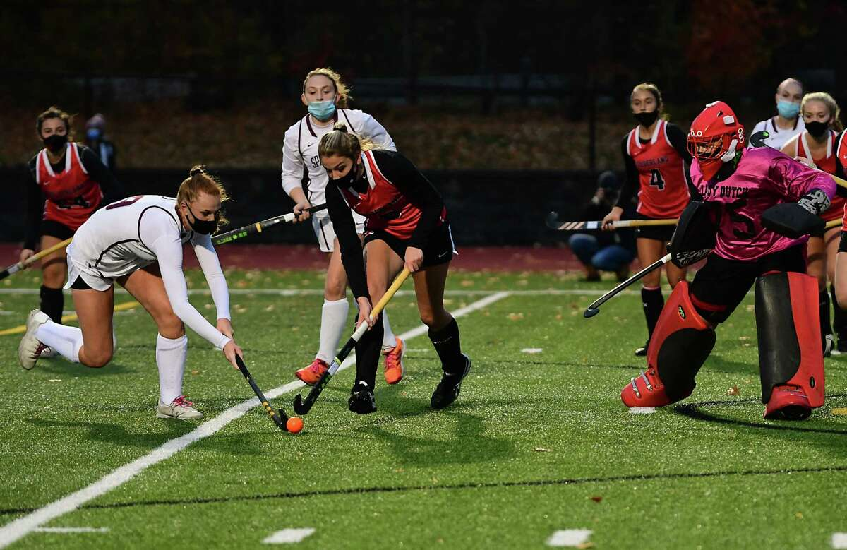Burnt Hills' Isabel Adams, left, and Guilderland's Caitlyn Caulfield battle for the ball in front of Guilderland's goal during a field hockey game on Monday, Oct. 26, 2020 in Burnt Hills, N.Y. (Lori Van Buren/Times Union)